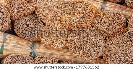 bundles of grass for thatched roof in Botswana Royalty-Free Stock Photo #1797681562