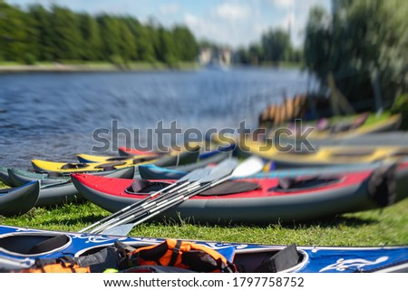 View of kayaking equipment, process of kayaking in the city river canal, with colorful canoe kayak boat paddling, process of canoeing, vibrant summer picture