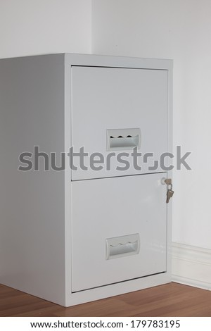 Key in a filing cabinet with white background, #179783195