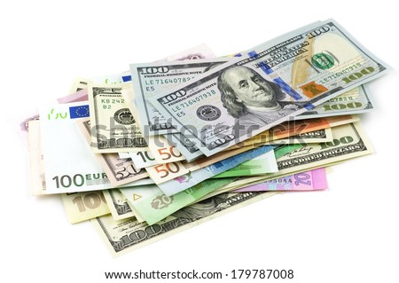 Pile of various currencies isolated on white background. #179787008