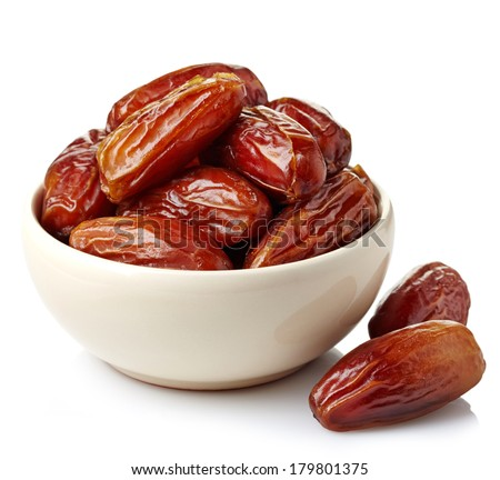Bowl of dried dates isolated on white background Royalty-Free Stock Photo #179801375