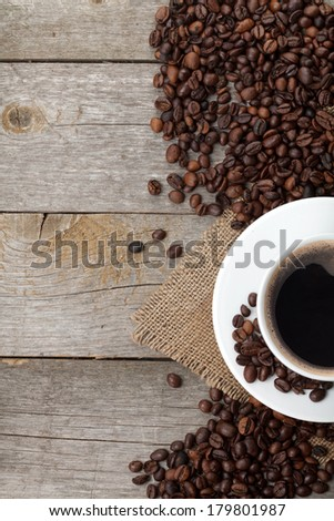 Coffee cup and beans on wooden table background with copy space #179801987