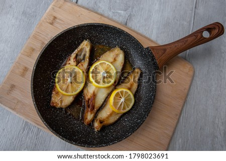 Halibut steak fried in a frying pan