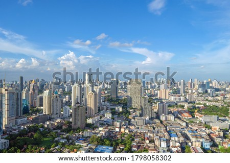Aerial view of Bangkok Downtown Skyline. Thailand. Financial district and business centers in smart urban city in Asia. Skyscraper and high-rise buildings at noon with blue sky. Royalty-Free Stock Photo #1798058302