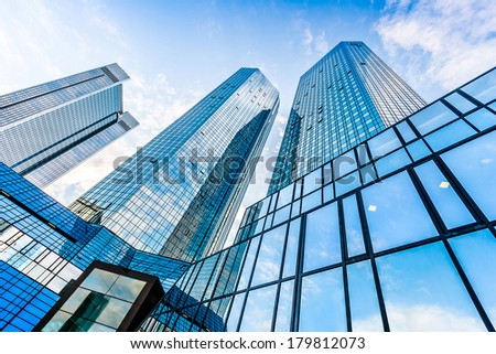 FRANKFURT - JULY 4: Bottom view of Deutsche Bank Twin Towers on July 4, 2013 in the central business district of Frankfurt am Main, Germany. Frankfurt is the largest financial centre in Europe. #179812073