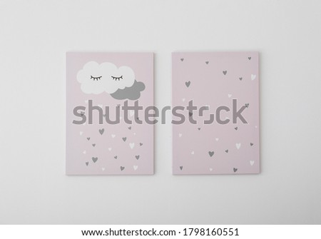 Adorable pictures of cloud and hearts on white wall. Children's room interior elements