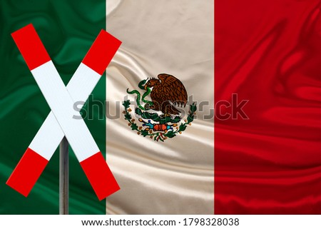 customs sign, stop, attention on the background of the silk national flag of mexico country, concept of border and customs control, violation of the state border, tourism restrictions