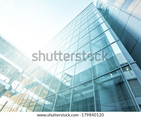 Panoramic and perspective wide angle view to steel blue background of glass high rise building skyscrapers in modern futuristic downtown at night Business concept of successful industrial architecture Royalty-Free Stock Photo #179840120