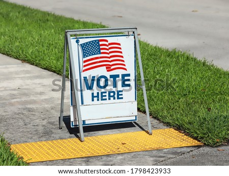 Vote Here Sign placed on the walkway to a neighborhood polling place, as seen on election day in Fort Lauderdale, Florida, USA #1798423933