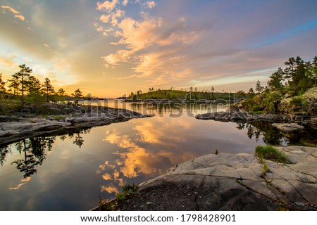 Lake in Karelia. Russia. Lake Ladoga at dawn. Nature regions of Russia. Skers of Lake Ladoga. Tourism Russia. Landscapes of Northern Nature. Rocky coast of Ladoga. Guide to Karelia. Russian north #1798428901