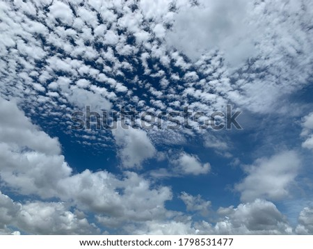 Cirrocumulus clouds are filled with beautiful streaks of clouds in the morning. Like small ripples a thin sheet of white ice crystals.no focus Royalty-Free Stock Photo #1798531477