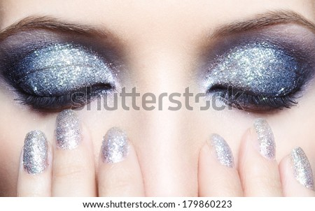 Closed eyes of young woman with vogue shining sparkle makeup #179860223