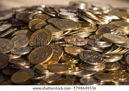 Heap of coins of the national currency of Kazakhstan tenge, copper coin. Various coins of Kazakhstan, coins for business, money, financial coins and economy #1798649536
