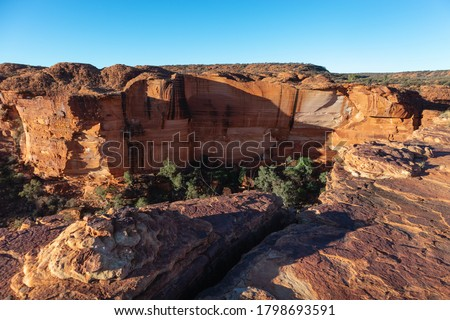 Vertical walls at Kings Canyon. Rock at the foreground. Wide angle picture. Watarrka national park, Northern Territory NT, Australia