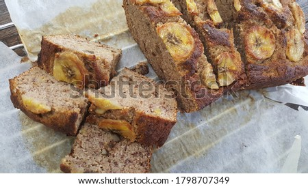 Selective focus view of home maded cinnamon banana bread with walnut freshly baked from oven. Traditional-style raised breads It taste moist, sweet, cake-like quick bread. #1798707349