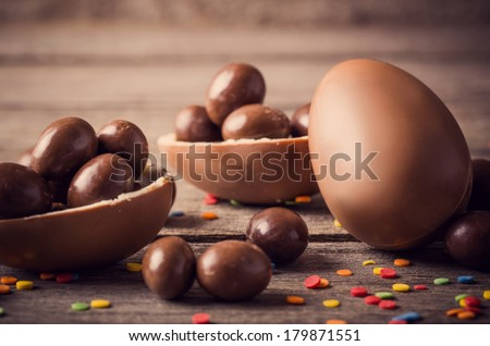 Chocolate Easter Eggs Over Wooden Background Royalty-Free Stock Photo #179871551