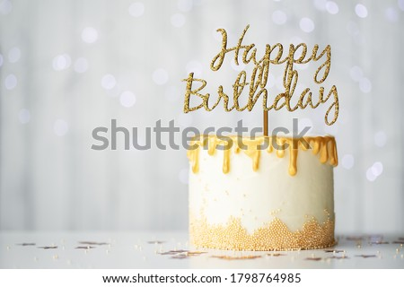 Golden birthday cake with happy birthday sign Royalty-Free Stock Photo #1798764985