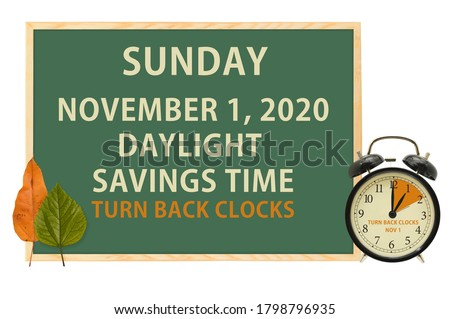 Daylight Savings Time Chalkboard with clock and leaves #1798796935
