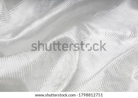Close up of fiberglass cloth composed into a wrinkled pattern