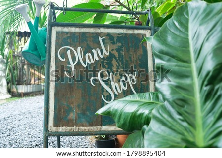 Plant shop sign in the garden
