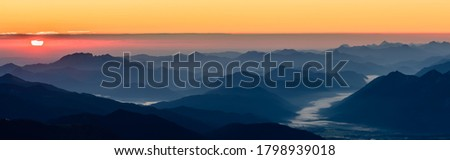 A panoramic picture of the sunrise over the alpine moutains range in Germany highest peak Zugspitze.