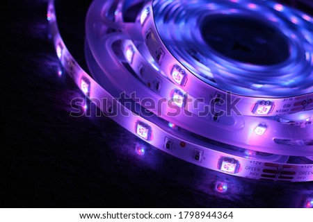 Multicolored LED strip, luminous ribbon for cold light interior lighting Royalty-Free Stock Photo #1798944364