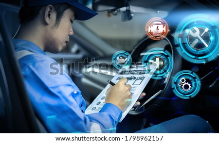 Mechanic engineer futuristic hologram icon repairing diagnosing checking motor vehicle car parts fixing issues problem broken engine, using clipboard pen man in professional uniform working in garage Royalty-Free Stock Photo #1798962157