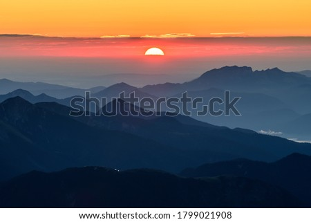 A picture of the sunrise over the alpine moutains range in Germanyfrom  highest peak Zugspitze.
