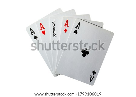 Five playing cards, four aces and a black joker on a white background