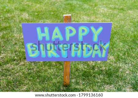 Happy Birthday Party Home Made Sign Staked in a Grassy Field