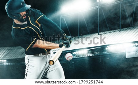 Porfessional baseball player with bat taking a swing on grand arena. Ballplayer on stadium in action. Royalty-Free Stock Photo #1799251744