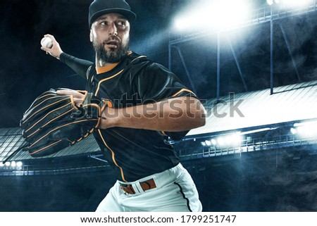 Porfessional baseball player with ball on grand arena. Ballplayer on stadium in action. Royalty-Free Stock Photo #1799251747