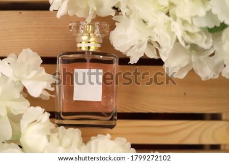 Chanel perfume bottle on fabric