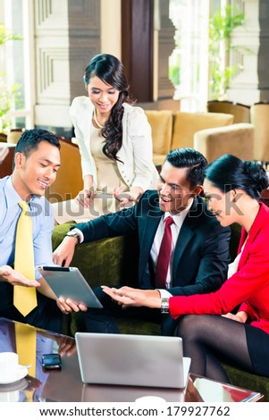 Asian businesspeople watching a tablet #179927762