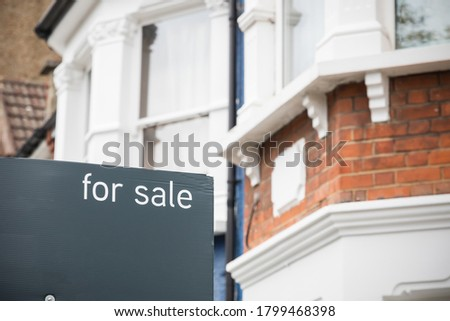 For Sale signs displayed outside terraced houses in Harringay, London