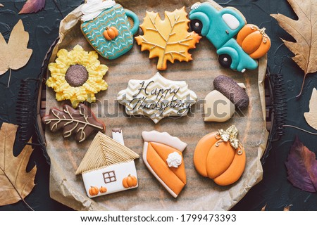 Happy Thanksgiving Day. Multicolored autumn cookies on a black background. Autumn concept