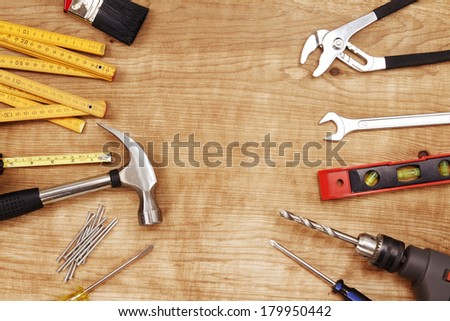 Assorted work tools on wood #179950442