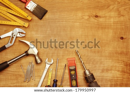 Assorted work tools on wood #179950997