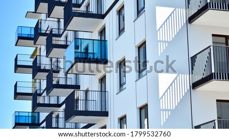 Architectural details of modern apartment building. Modern european residential apartment building complex. Royalty-Free Stock Photo #1799532760