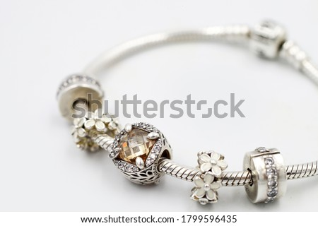 Women's Bracelet Pandora, Charms close-up, jewelry. Royalty-Free Stock Photo #1799596435