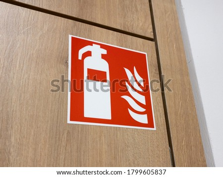 Fire extinguisher sign on a wall