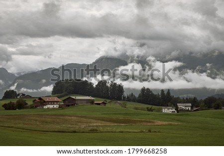 View of Mt. Watzmann in the Berchtesgaden Alps on an overcast day in summer in Bischofswiesen, Germany. Alpine mountain landscape with strong clouds. Royalty-Free Stock Photo #1799668258