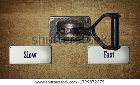 Street Sign the Direction Way to Fast versus Slow Royalty-Free Stock Photo #1799872375