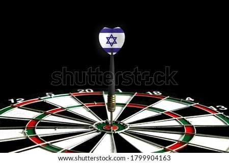 The flag of Israel is featured on the dart board game, the concept of achieving goals.