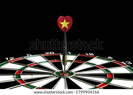 The flag of Vietnam is featured on the dart board game, the concept of achieving goals.