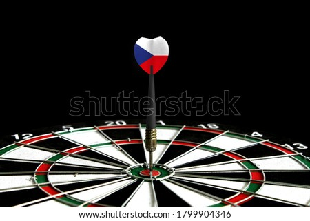The flag of Czech Republic is featured on the dart board game, the concept of achieving goals.