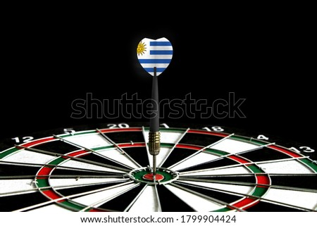 The flag of Uruguay is featured on the dart board game, the concept of achieving goals.