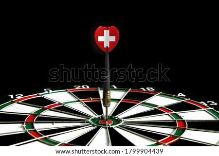 The flag of Switzerland is featured on the dart board game, the concept of achieving goals.