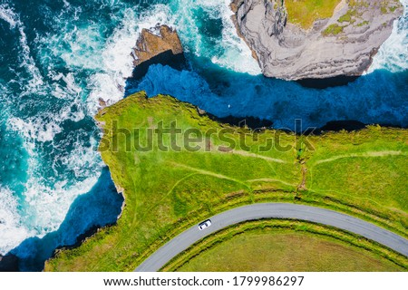 Top-down aerial view over the Irish rugged coastline at Kilkee Cliffs, Co Clare. Epic Irish  Seascape along the wild Atlantic way.The natural beauty of the cliff edge and the blue Atlantic ocean. #1799986297