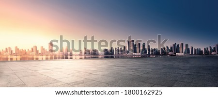Panoramic skyline and buildings with empty space dark concrete square floor. Sunrise over the city view. City urban Landscape. #1800162925
